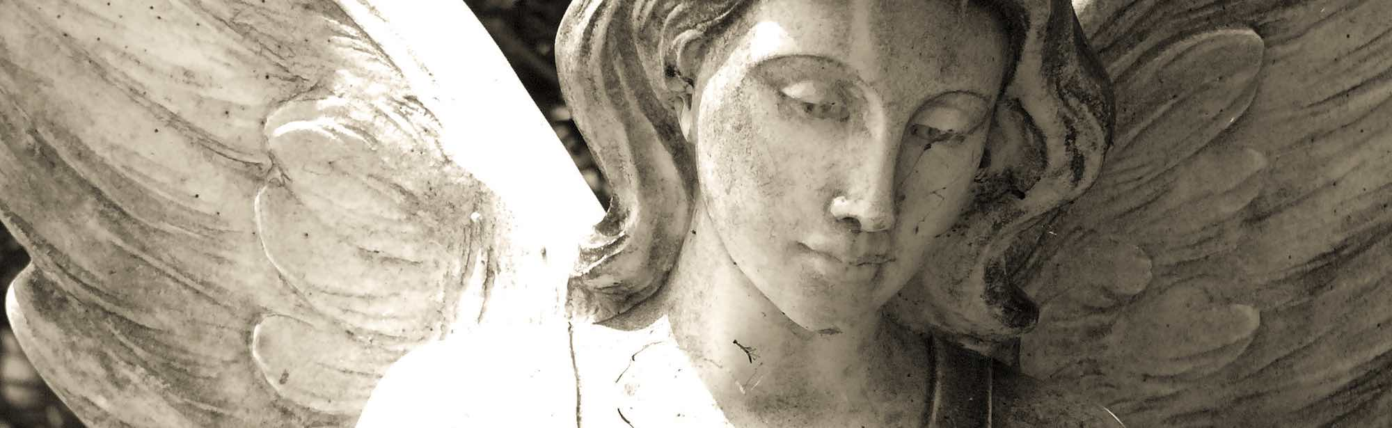 Close up of statue of a female angel in Bonaventure Cemetery
