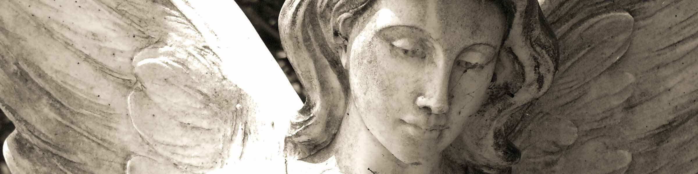 Close up of statue of a female angel in Bonaventure Cemetery.