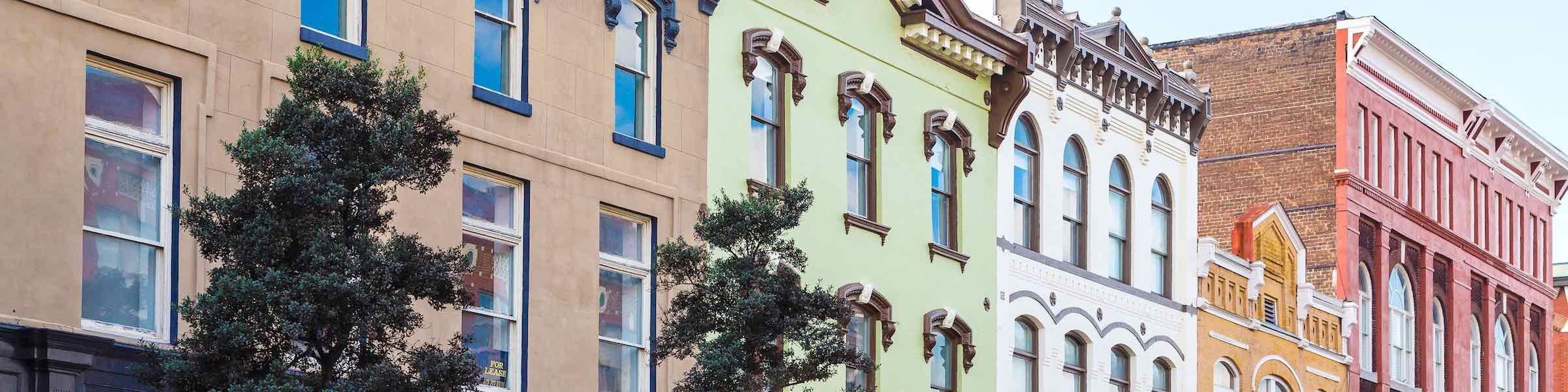 Colorful historic buildings along Broughton Street, Savannah, GA.
