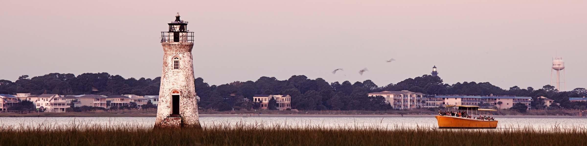 Sunset view of Cockspur Island Lighthouse and Tybee Island, GA.