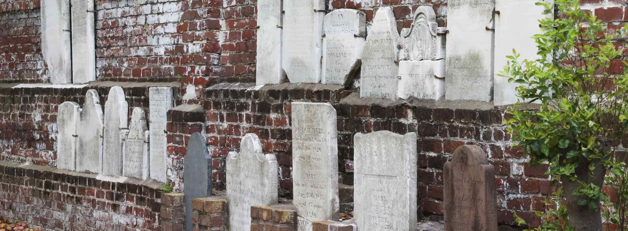 Grave stones mounted on the rear wall in Savannah's Colonial Park Cemetery