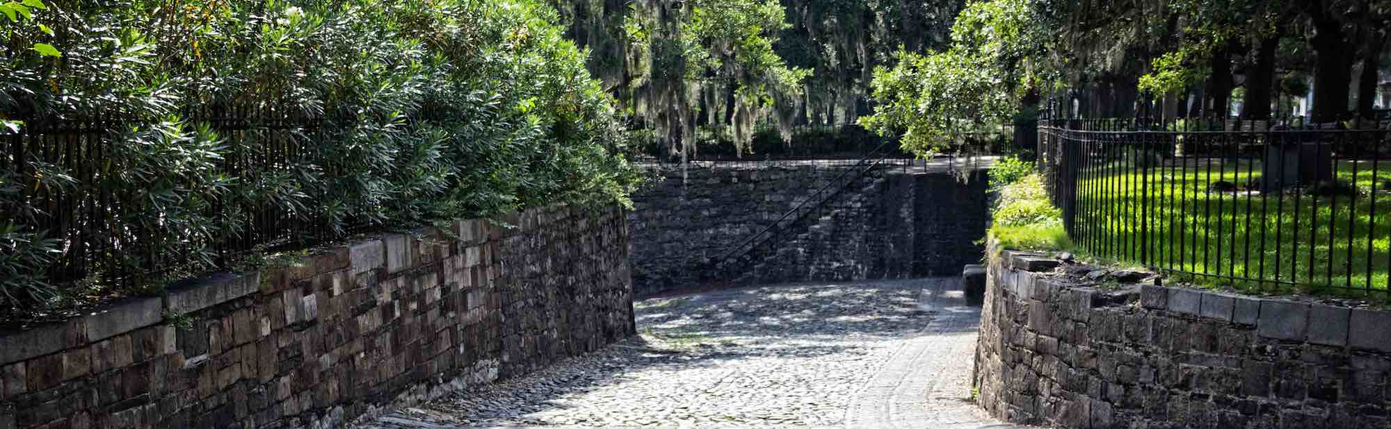 Cobblestone ramp and walls around the perimeter of Savannah, GA's Emmet Park.