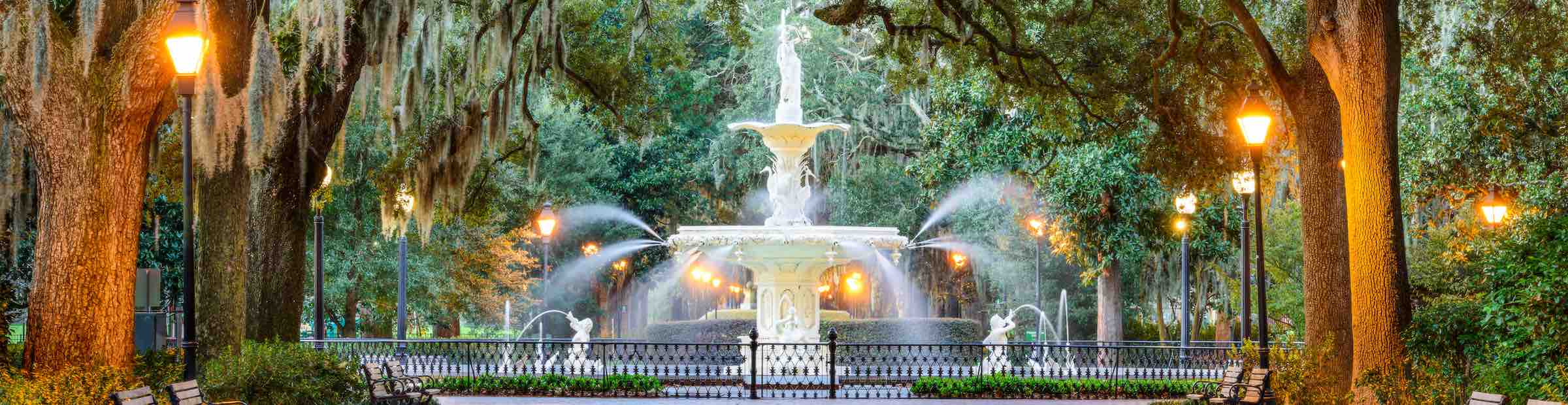 An evening view of the fountain in Forsyth Park.