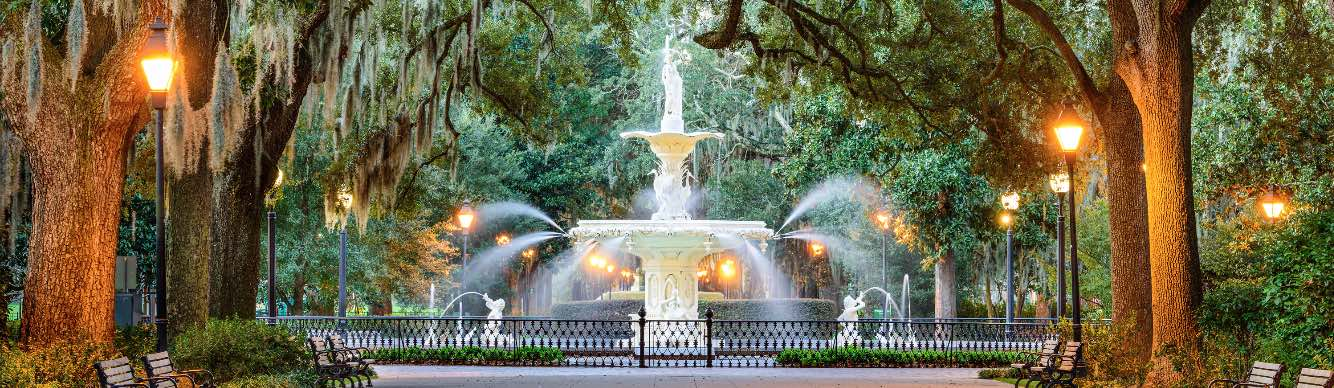 An evening view of the fountain in Forsyth Park