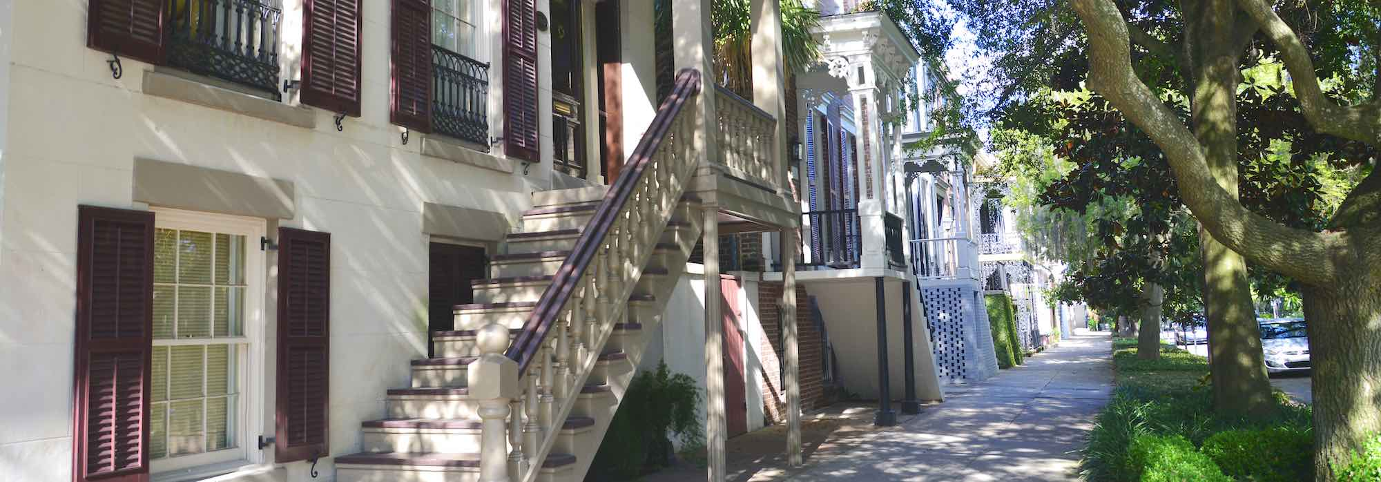 A view of historic houses along a street in Savannah's Historic District.