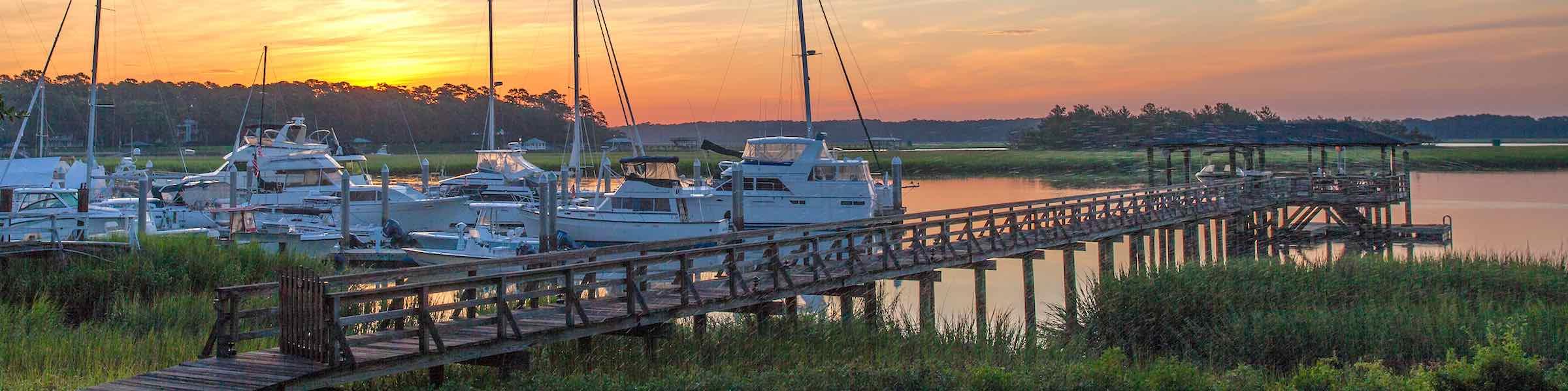 Boats on the Skidaway River at Isle of Hope, Savannah, GA, at sunset.