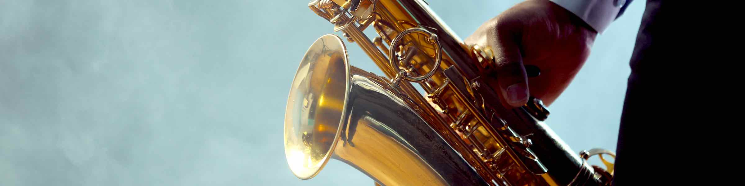 Abstracted image of a man playing a saxophone.