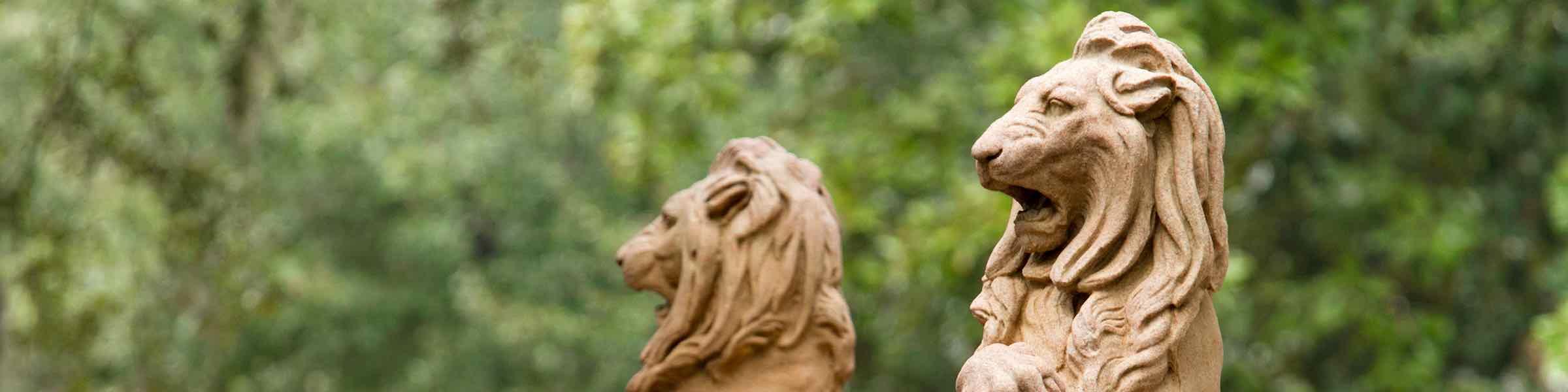 Carved lion figures at the base of the Oglethorpe Monument in Savannah, GA.
