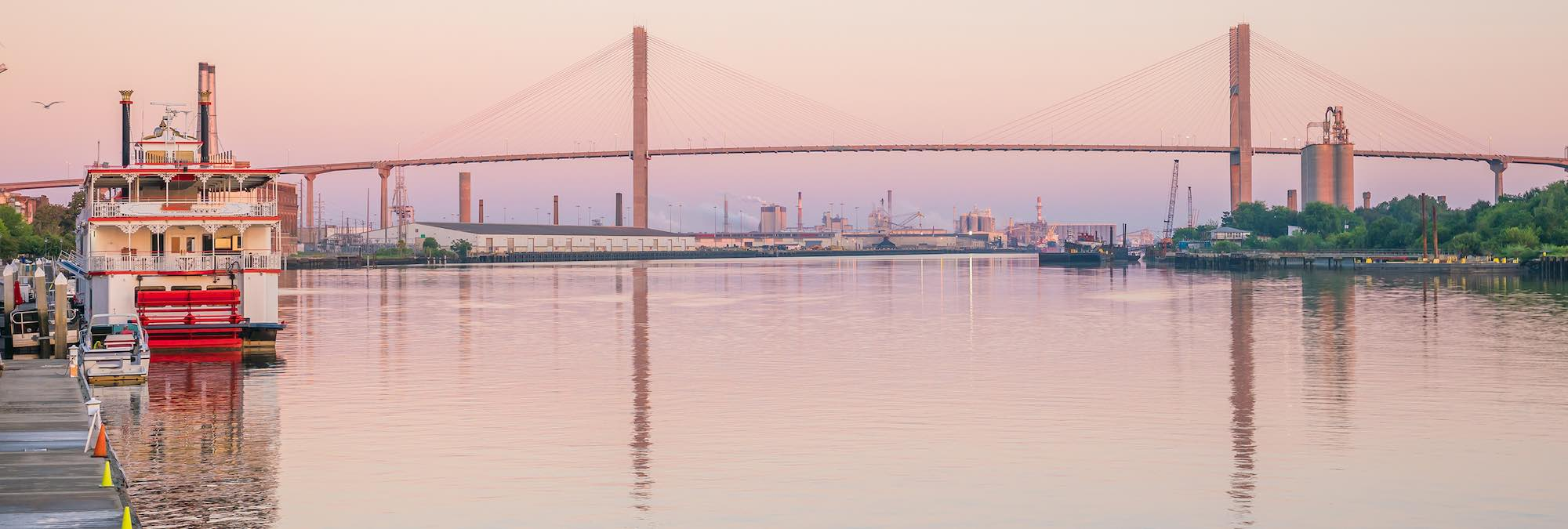 Savannah river boat and the Talmadge Bridge at twilight.