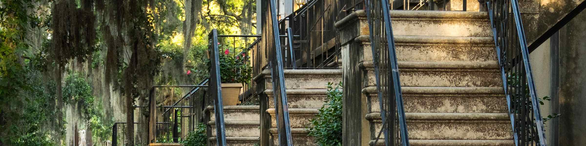 Steep stairs enter historic row houses in Savannah, GA.